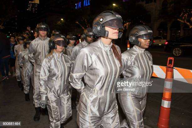 A group of sixers parade past the red carpet at the world premiere of Ready Player One during the SXSW Film Festival on March 11 2018 in Austin Texas