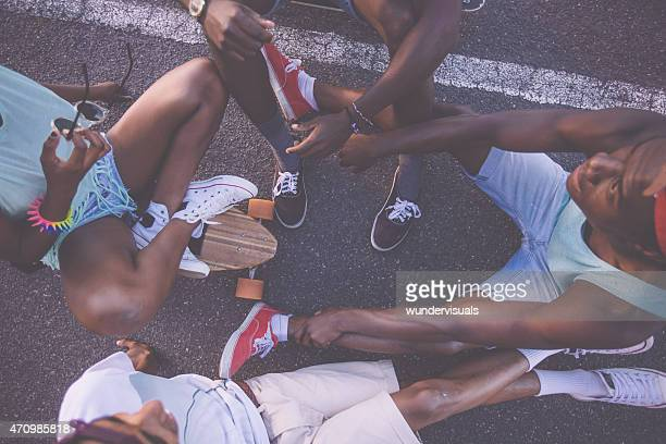 Group of skater friends sitting in a circle on longboards
