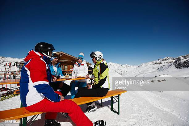 Group of Skier at mountain hut having a champagne