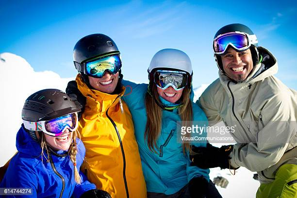Group of skiers laughing.