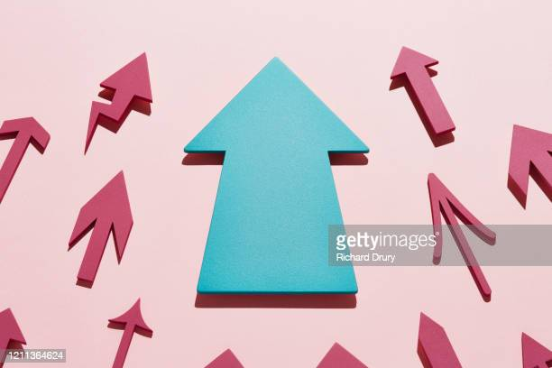a group of small arrows moving up led by a big arrow - growth stock pictures, royalty-free photos & images
