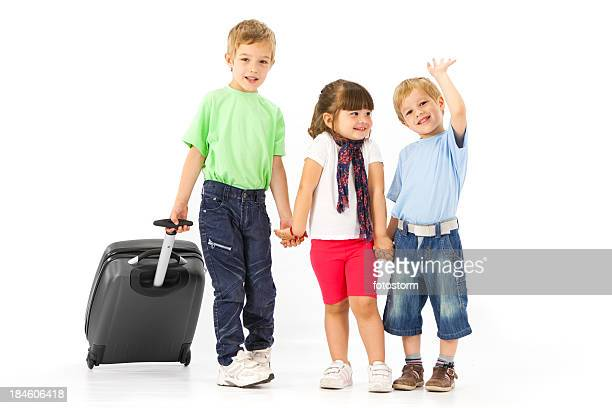 Group Of Small Children With Suitcase Traveling