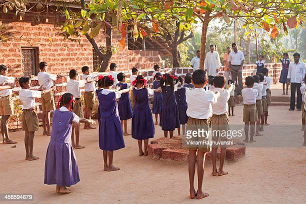 Group of small Indian children in Rural School Morning Assembly