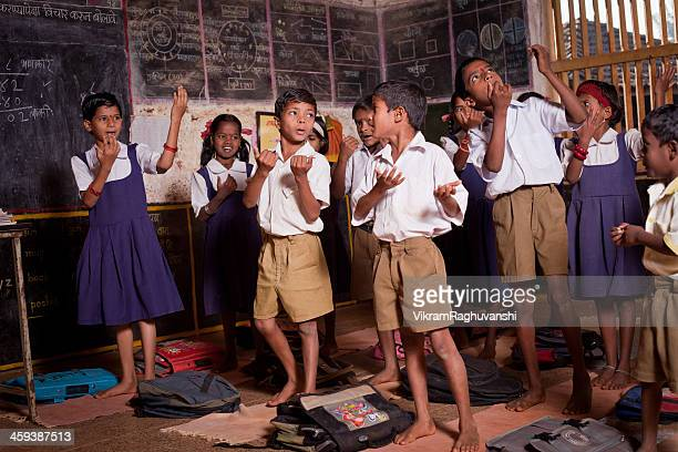 Group of small Indian children performing in a Rural School