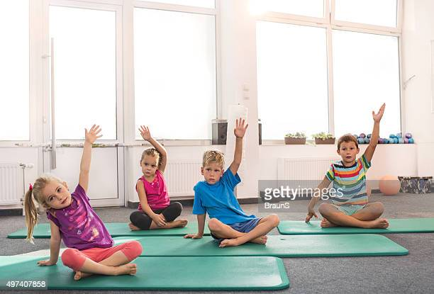 Group of small kids exercising in a health club.
