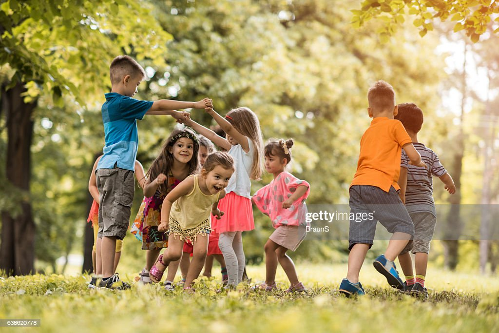 Group of small kids having fun while playing in nature. : Stock Photo