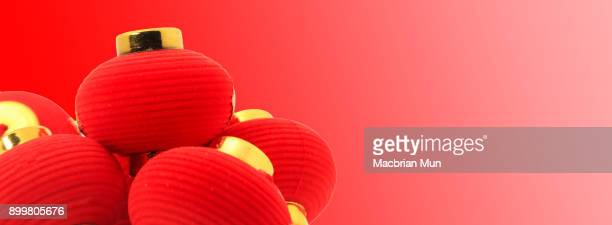Group of small red Chinese lanterns for decoration over red background