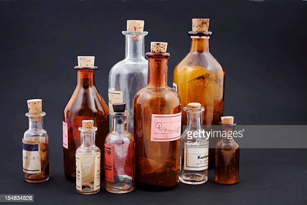 group of small vintage translucent medicine bottles. - toxic substance stock photos and pictures