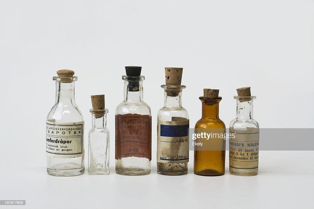 Group of small vintage translucent medicine bottles. : Stock Photo