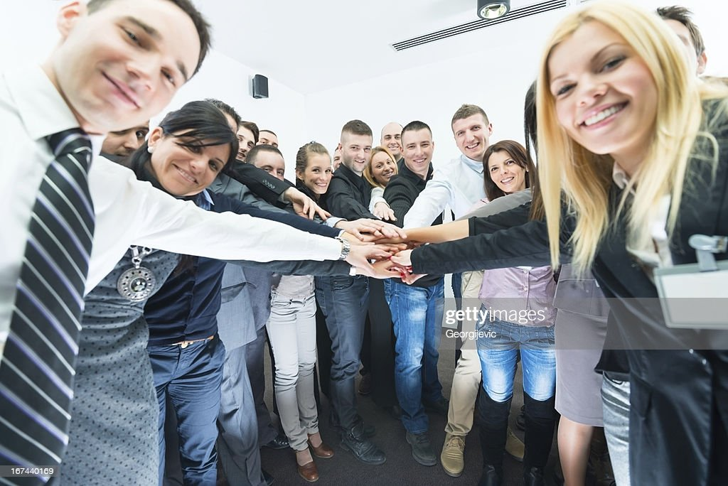 Group of smiling business people together celebrating their success : Stock Photo