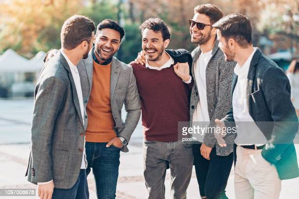 group of smiling businessmen outdoors in the city - smart casual stock pictures, royalty-free photos & images