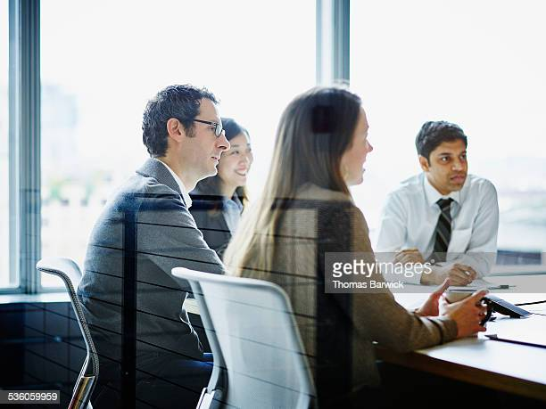 Group of smiling businesspeople in meeting