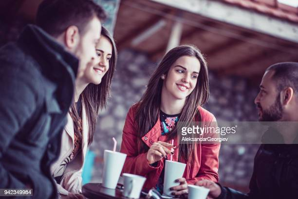 Group of Smiling Friends Having Conversation in a Cafe Restaurant