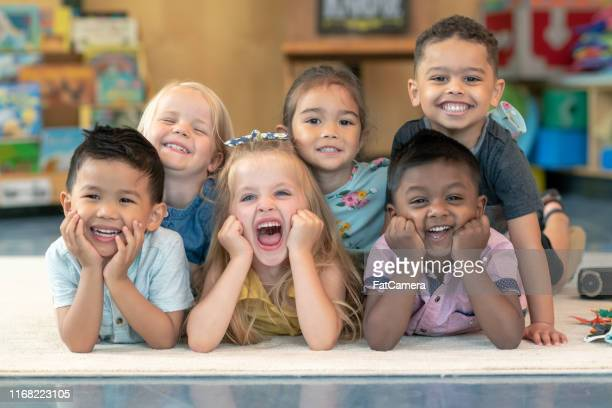 group of smiling preschool students - children only stock pictures, royalty-free photos & images