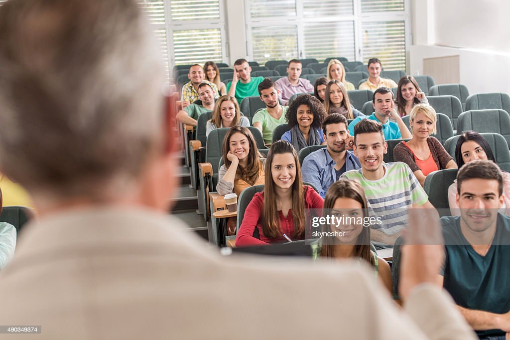 Group of smiling students in the amphitheatre during lecture. : Stock Photo