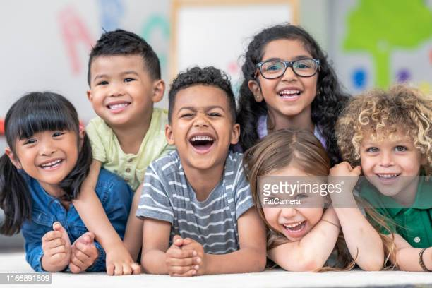 group of smiling students - montessori education stock pictures, royalty-free photos & images
