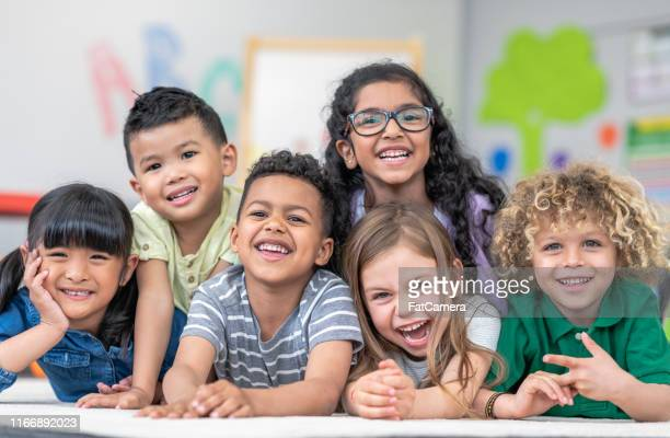 group of smiling students - preschool stock pictures, royalty-free photos & images