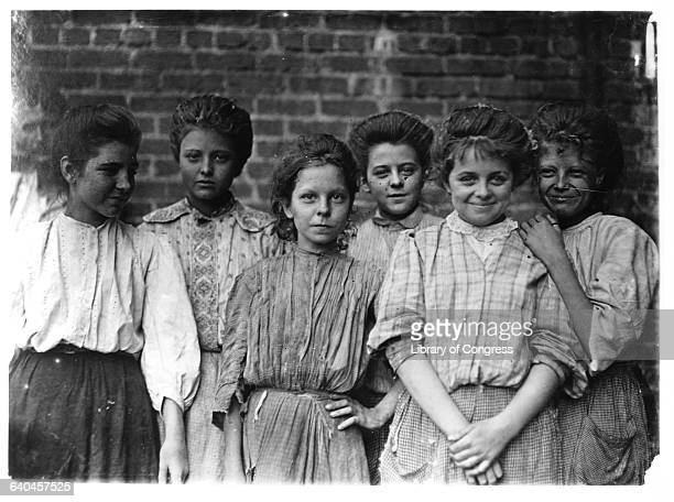 Group of smiling teenage girls work together at a cotton mill. | Location: George Cotton Mill, Georgia, USA.