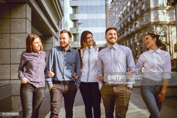 group of smiling young students walking on the street and talking - aleksandar georgiev stock photos and pictures