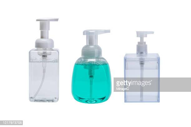 group of soap dispenser on white - alcool gel imagens e fotografias de stock