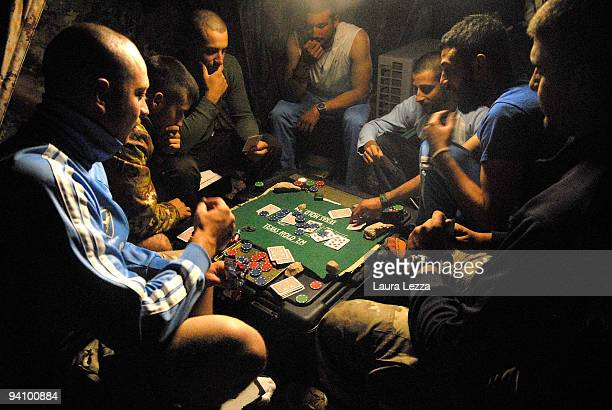 A group of soldier of the Folgore Parachute Brigade play cards in their tent during their downtime on September 16 2009 in Shindand Military Base...