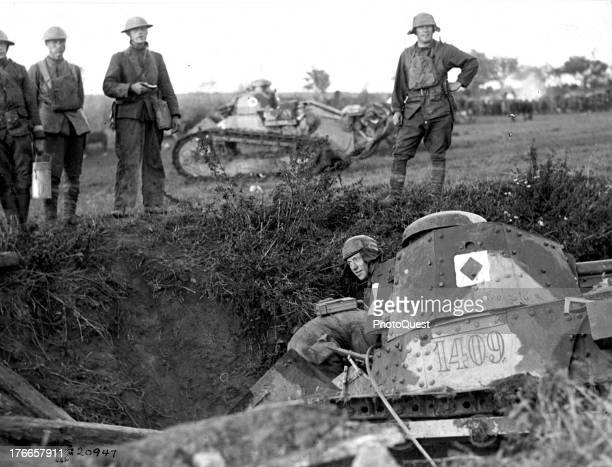 Group of soldiers assist in pulling a tank out of a ditch where it had tumbled in the attack of the Americans on the east line of the St. Mihiel...