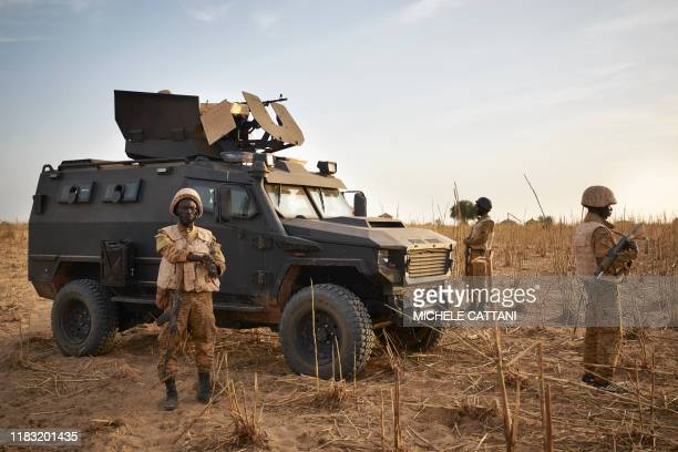 Group of soldiers from the Burkina Faso Army patrols a rural area during a joint operation with the French Army in the Soum region along the border...