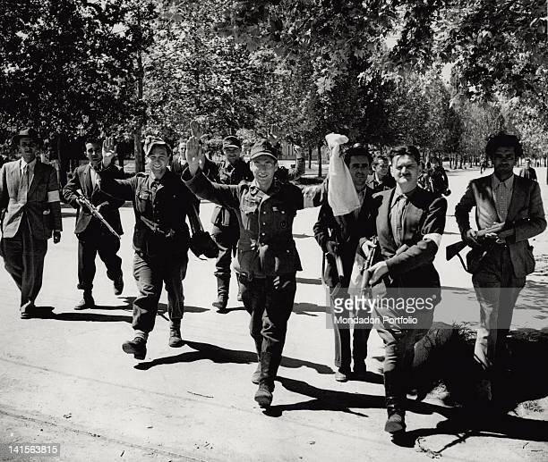 Group of soldiers from the German rear, their arms raised in sign of surrender, is escorted by a partisan unit. Modena, 22nd April 1945.