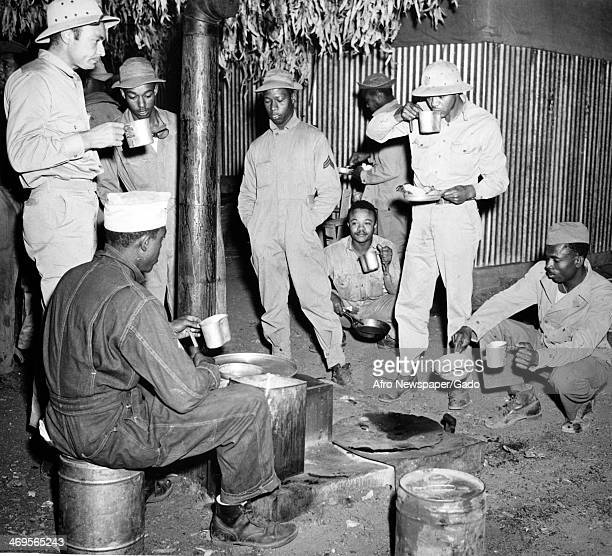 A group of soldiers having a meal before leaving Queensland for the North Queensland Australia March 11 1943