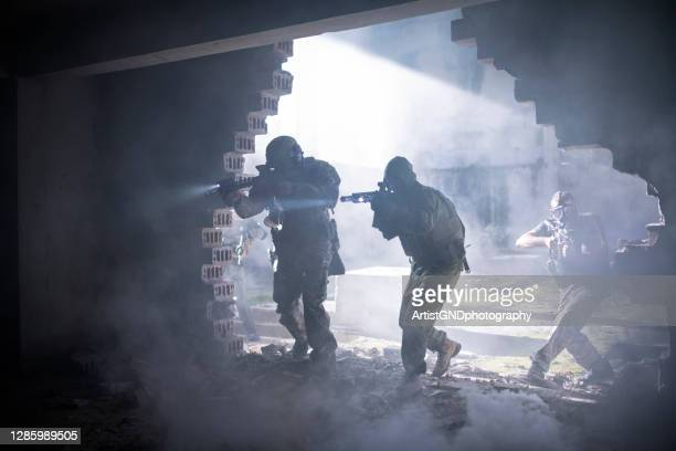 group of soldiers make a rescue operation - terrorism stock pictures, royalty-free photos & images