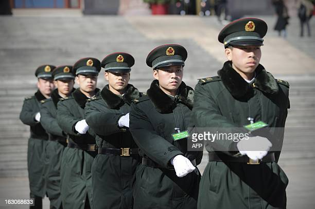 A group of soldiers make their way in front of the Great Hall of the People in Beijing on March 4 2013 Thousands of delegates from across China meet...