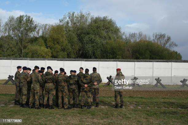 A group of soldiers of the Bundeswehr the German armed forces tour a section of the former Cold Warera fortified border between East Germany and West...