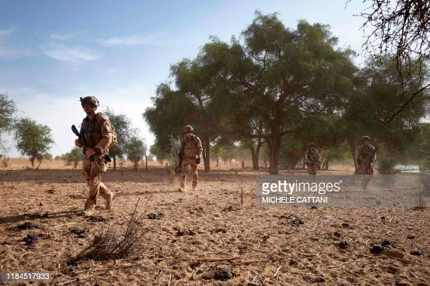 A group of soldiers of the French Army patrols the forest of Tofa Gala during the Bourgou IV operation in the Sahel region in northern Burkina Faso...