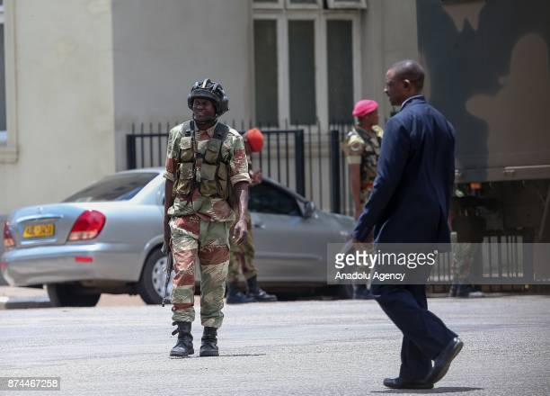 A group of soldiers seal off a main road to the parliament building within the military activities taking place in Harare Zimbabwe on November 15...