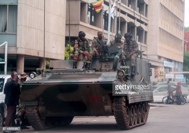 A group of soldiers seal off a main road to the parliament building within the military activities taking place in Harare Zimbabwe on November 16...