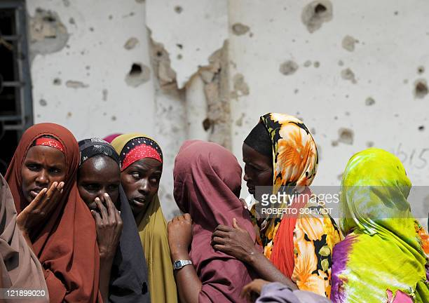 A group of Somali women line up to receive food aid from a Kuwaiti based Islamic charity in Somalia's capital Mogadishu on August 14 2011 Over 100000...