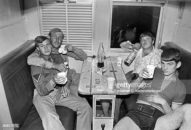 A group of South African exnational servicemen celebrate the end of their year of army service with a drink on the train home 1st July 1974