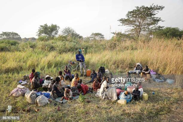 A group of South Sudanese refugees fleeing from recent fighting in Lasu in South Sudan rest after crossing the border into the Democratic Republic of...