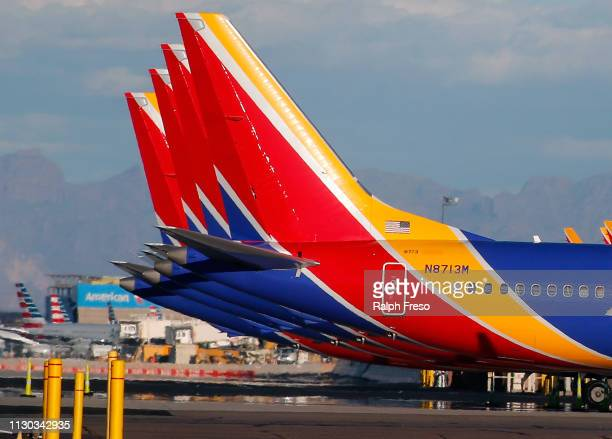 A group of Southwest Airlines Boeing 737 MAX 8 aircraft sit on the tarmac at Phoenix Sky Harbor International Airport on March 13 2019 in Phoenix...