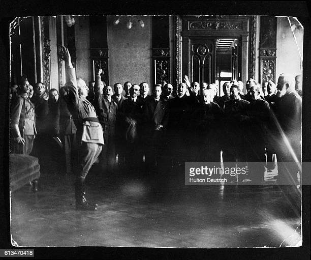 A group of Spanish fascists saluting General Franco's selfappointment as dictator or Caudillo of Spain during the Spanish Civil War