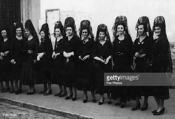 A group of Spanish ladies wearing the traditional mantilla for Semana Santa or Holy Week in Seville circa 1935