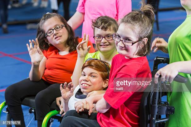 Group of special needs girls in gym exercise class