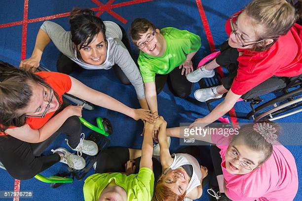 group of special needs girls showing team spirit - sports team event stock photos and pictures