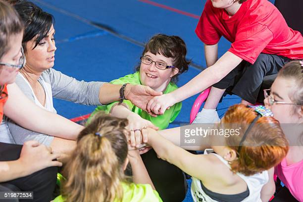Group of special needs girls showing team spirit