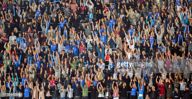 group of spectators cheering in stadium - chanting stock pictures, royalty-free photos & images