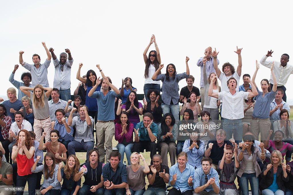 Group of spectators cheering : Stock Photo
