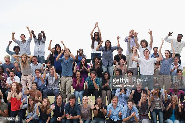 group of spectators cheering - crowd stock pictures, royalty-free photos & images