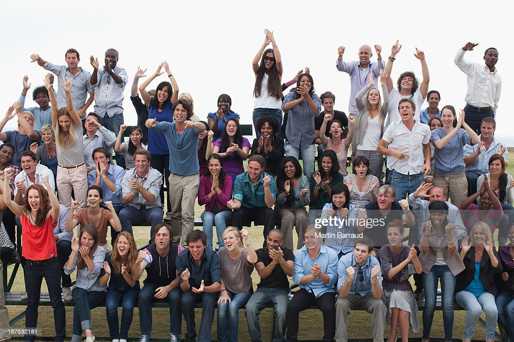 Group of spectators cheering : Stock Photo