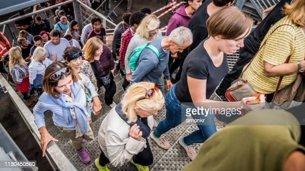 group of spectators entering stadium - entering stock pictures, royalty-free photos & images