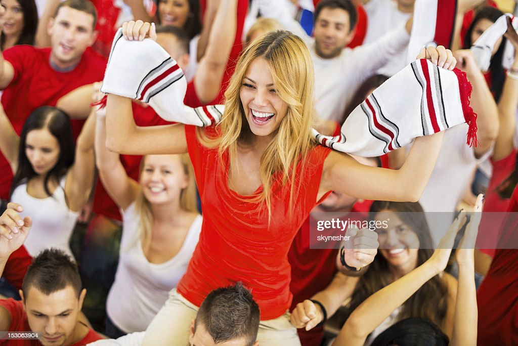 Group of sport fans cheering. : Stock Photo